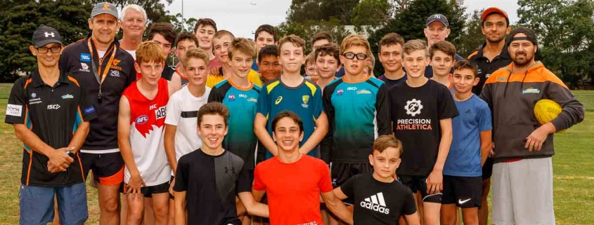 Coaches John Nandlal and Leon Cameron, far left, with the U14s and coaching team